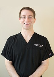 Dr. Perri in Black Scrubs
